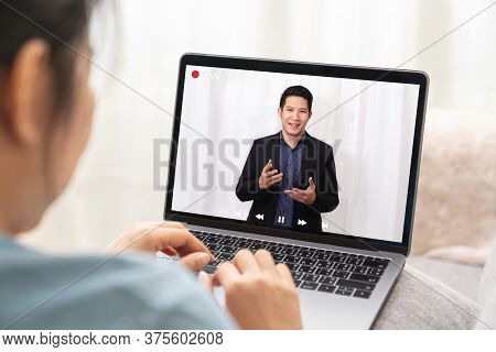 Young Asian Chinese Leader Or Businessman On Management Forum, Teleconference, Town Hall Or Press Vi