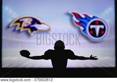 Baltimore Ravens Vs. Tennessee Titans . Nfl Game. American Football League Match. Silhouette Of Prof