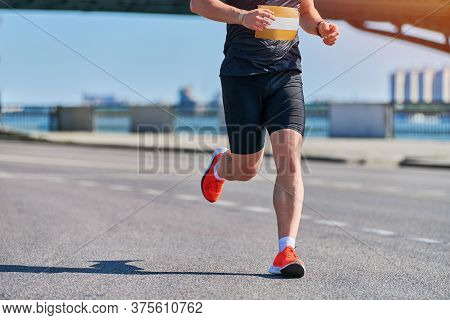 Running Man. Athletic Man Jogging In Sportswear On City Road. Healthy Lifestyle, Fitness Sport Hobby