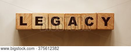Word Legacy On Wooden Cubes On Light Background With Shadow. Last Will Concept