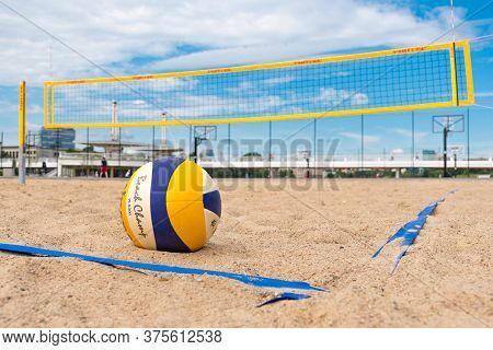 Vilnius, Lithuania - July 3 2020: Beach Volley, Ball On The Sand And Net On Background