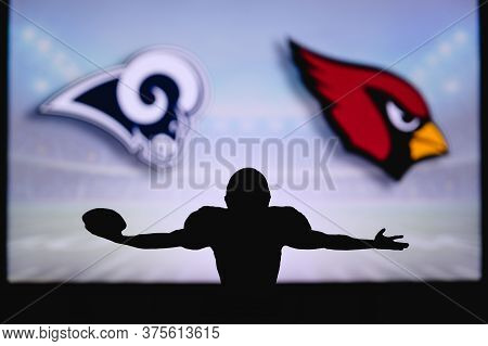 Los Angeles Rams Vs. Arizona Cardinals. Nfl Game. American Football League Match. Silhouette Of Prof