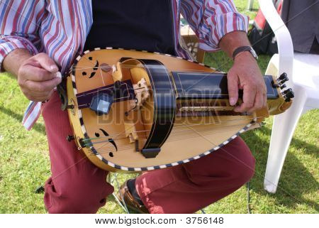 Playing A Musical Instrument Called Hurdy Gurdy