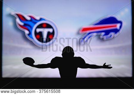 Tennessee Titans Vs. Buffalo Bills . Nfl Game. American Football League Match. Silhouette Of Profess