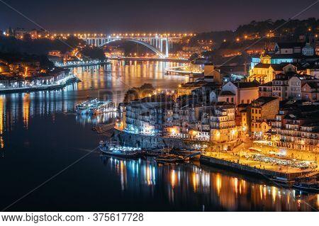 Night City Skyline Of Porto From Luis I Bridge Over Douro River, Portugal