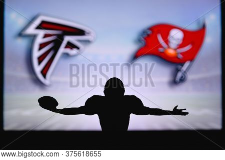 Atlanta Falcons Vs. Tampa Bay Buccaneers. Nfl Game. American Football League Match. Silhouette Of Pr