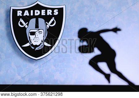 Las Vegas Raiders. Silhouette Of Professional American Football Player. Logo Of Nfl Club In Backgrou