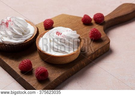 Concept Of Sweet Food With Two Cup Cakes With Cream And Berries At Pink Background