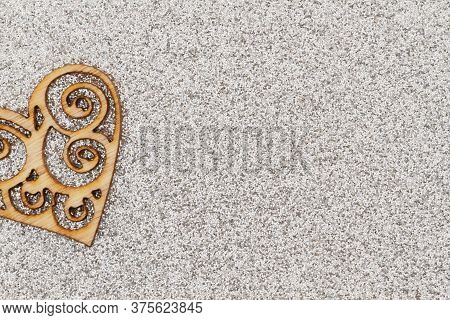 Wood Die Cut Heart With Silver Glitter Textured Paper Background