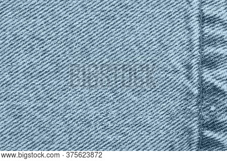 Blue Jeans Denim Material With Stiches Background With Copy Space For Message Or Use As A Texture