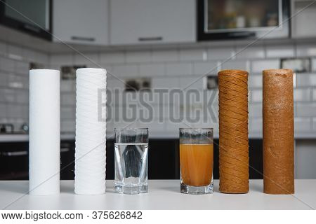 Water Filter Cartridge Used And A Glass Of Rusty Water Brown Coloring And New Filter And A Glass Of
