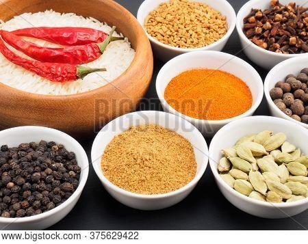 Basmati Long, Rice, Black Pepper, Masala Powder, Fenugreek, Green Cardamom, Hot Red Chili Pepper, Cl