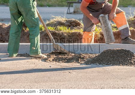Road Works. The Installation Of New Concrete Curbs