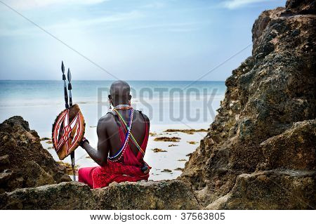 Maasai sitting by the ocean