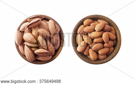 Studio Shot Of Almonds On White Background. Heap Of Almond Isolated On White. Nuts In A Bowl With Co