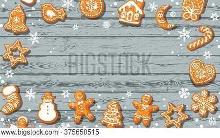 Christmas Background. Cute Gingerbread Cookies On Old Blue Wooden Table With Copy Space