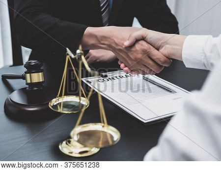 Handshake After The Male Lawyer Is Providing Service To Consult Business Dispute To Businessman.