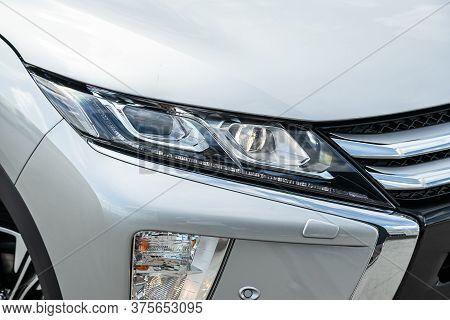 Novosibirsk/ Russia - July 04 2020: Mitsubishi Eclipse Cross, White Car Headlights. Exterior Detail.