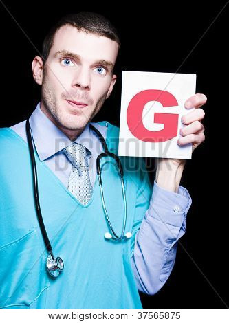 Male Gynaecologist Doctor Holding Gynaecology Sign