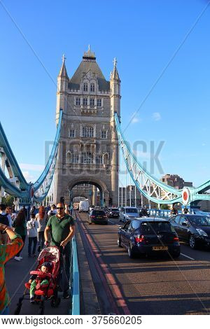 London, Uk - July 8, 2016: People Walk Across The Tower Bridge In London, Uk. London Is The Most Pop