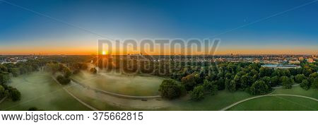 Wonderful Sunrise Over The Englischer Garten Of Munich, A Green Park In Summer.