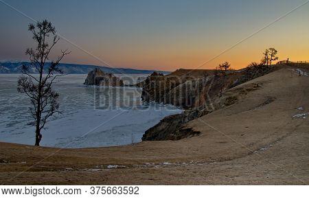 Russia. The Lake Baikal. Dawn On Cape Burhan Of Olkhon Island.