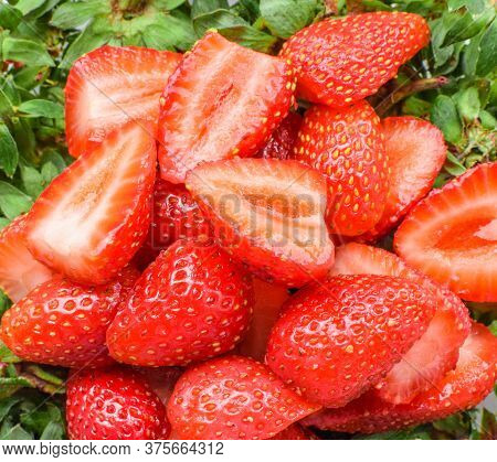 Liced Strawberries As Texture And Background. Fresh Slice Strawberry, Macro, Red Background.