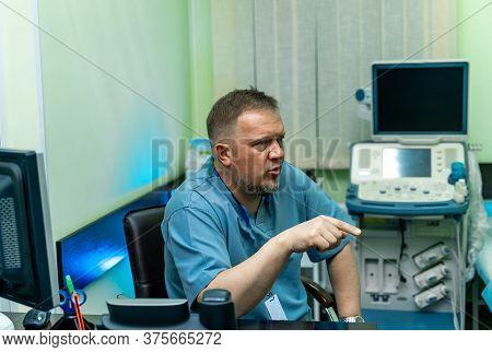 Doctor Near Ultrasound Equipment. Diagnostics. Sonography. Portrait. Closeup