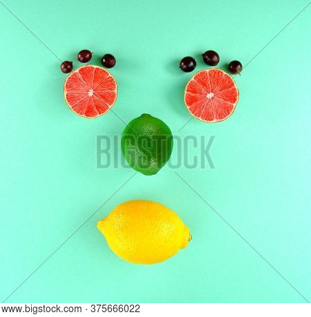 Grapefruit Face. Fruit Face. Lime Isolate On Turquoise Background.lime Top View. Green Lemon Lies On