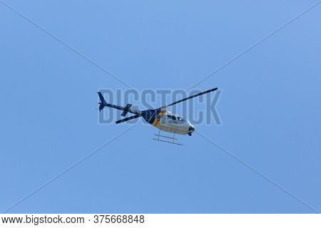 Woodbridge, New Jersey - June 1, 2020: A New Jersey State Police Helicopter Circles The Area During