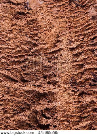 Chocolate Ice Cream Tub Texture Background, Macro Shot. Vertical