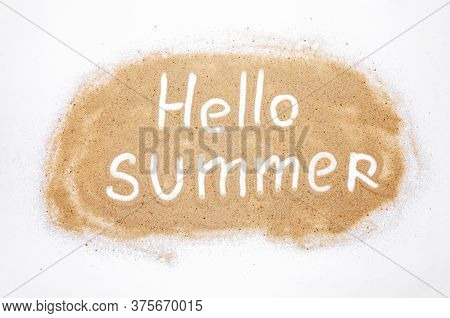 Word Hello Summer On Sand Isolated On White Background. Top View. Flat Lay