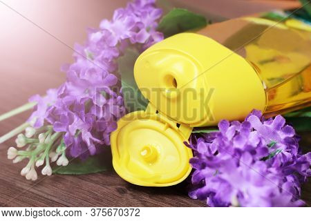 Yellow Shower Gel And Purple Flowers So Close