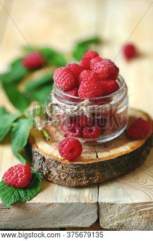 Fresh Raspberries In A Jar. Raspberry Leaves. Harvest Raspberries.