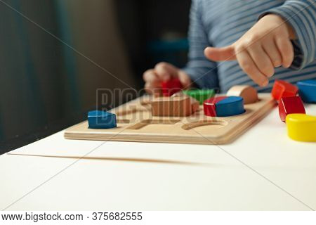 Educational Toys, Cognitive Skills, Montessori Activity. Closeup: Hands Of A Little Montessori Kid L
