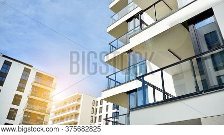 Modern Apartment Buildings On A Sunny Day With A Blue Sky. Facade Of A Modern Apartment Building. Gl