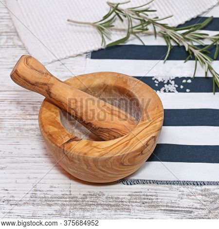Olive Wood Mortar And Pestle And Sprig Of Rosemary Herbs
