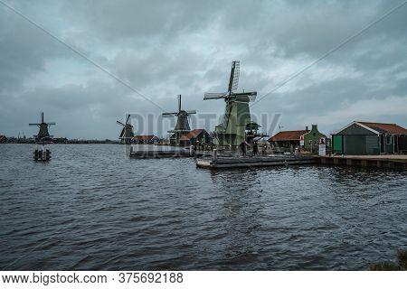 Zaandam, Netherlands - March 6, 2020: Windmills In Zaanse Schans In Zaandam City. Museum Village In
