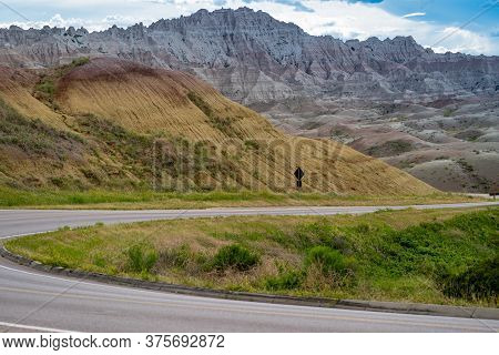 Winding Road Through The Badlands National Park In South Dakota Near Yellow Mounds Overlook