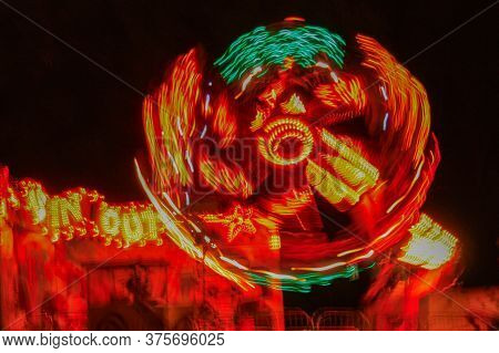 Carousel , A Blurry Beautiful Red Carousel In Motion At The Amusement Park With Night Light.