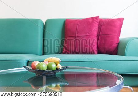 Fresh Fruit And Green Sofa With Red Backrest Pillow In Living Room