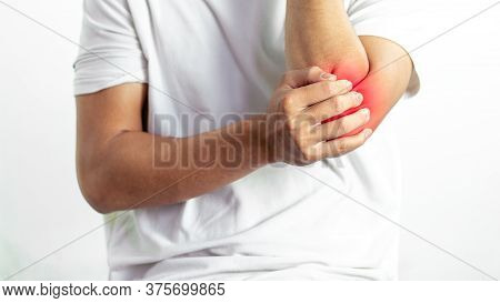 Closeup On Man With Elbow Pain,medical Concept