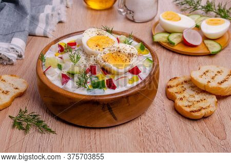 Cold Soup With Raw Vegetables And Eggs In A Dish On A Wooden Background. Selective Focus.