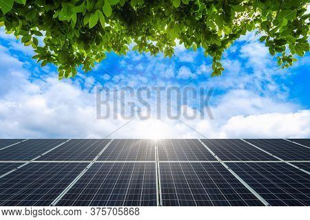 Green Leaves Frame With Photovoltaic Solar Power Panel On View Spring Blue Sky Background, Green Cle