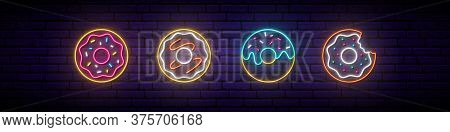 Neon Donut Sign. Glowing Neon Donut Icons On Dark Brick Wall Background. Neon Signboard. Donut Emble