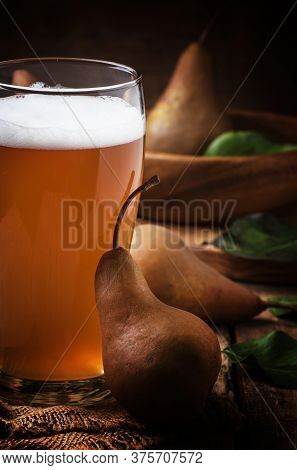 Spicy Homemade Cider Of Autumn Brown Pears, Vintage Wooden Background, Rustic Style, Selective Focus