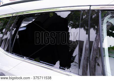 Criminal incident. Hacking the car. Broken window of a car. Broken car's window. Concept of vandalis
