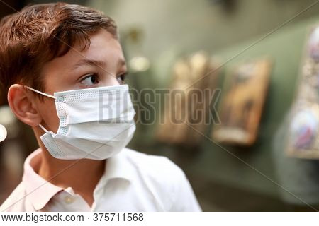 Boy Wearing Medical Protection Mask In Museum