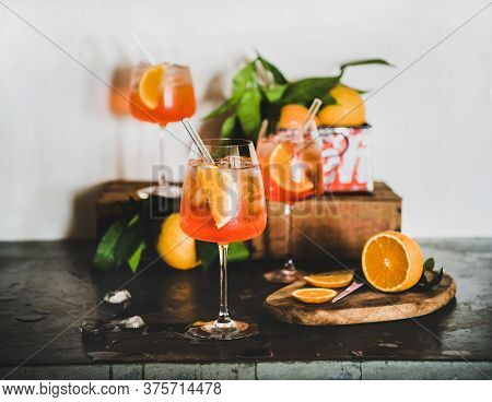 Aperol Spritz Cocktail In Glasses With Orange Slices And Ice