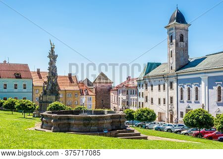 Kremnica,slovakia - July 9,2020 - View At The Main Square With Baroq Fountain,plague Column And Cloi